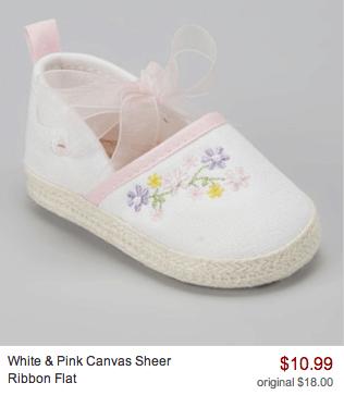 white pink canvas shoe