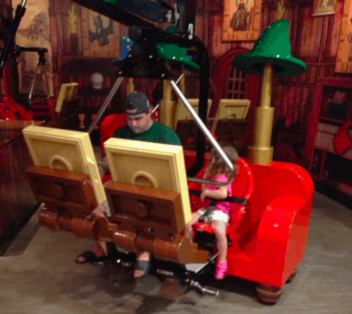 Daughter and Daddy about to go on a ride!  I can barely get her to look at the camera the entire time!
