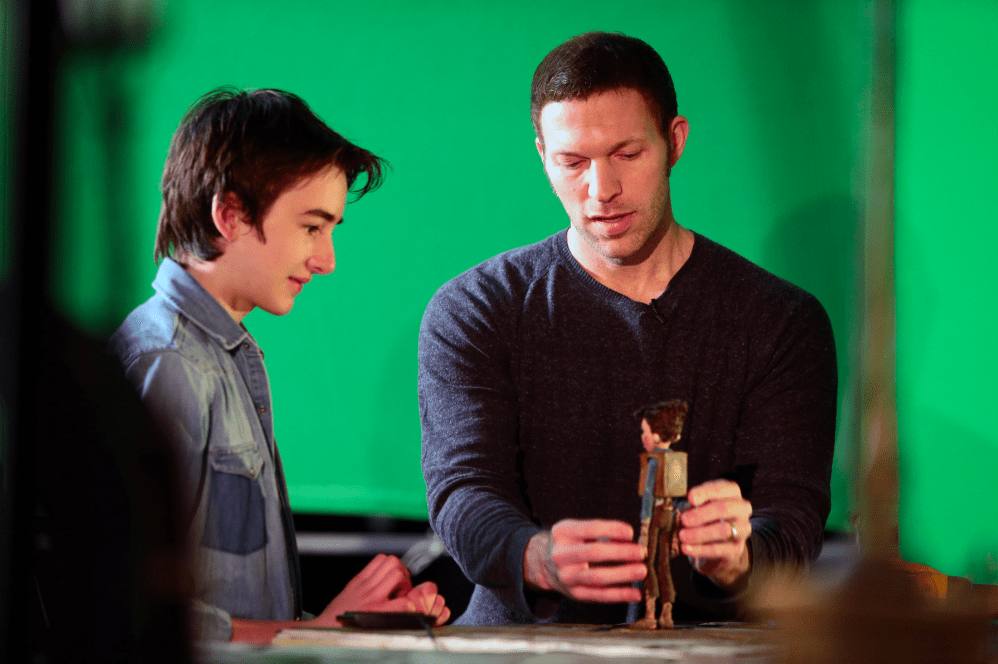 (L to R) Voice talent Isaac Hempstead-Wright visits with LAIKA CEO and Lead Animator Travis Knight during production of LAIKA and Focus Features' family event movie THE BOXTROLLS, opening nationwide September 26th. Credit:  LAIKA, Inc.