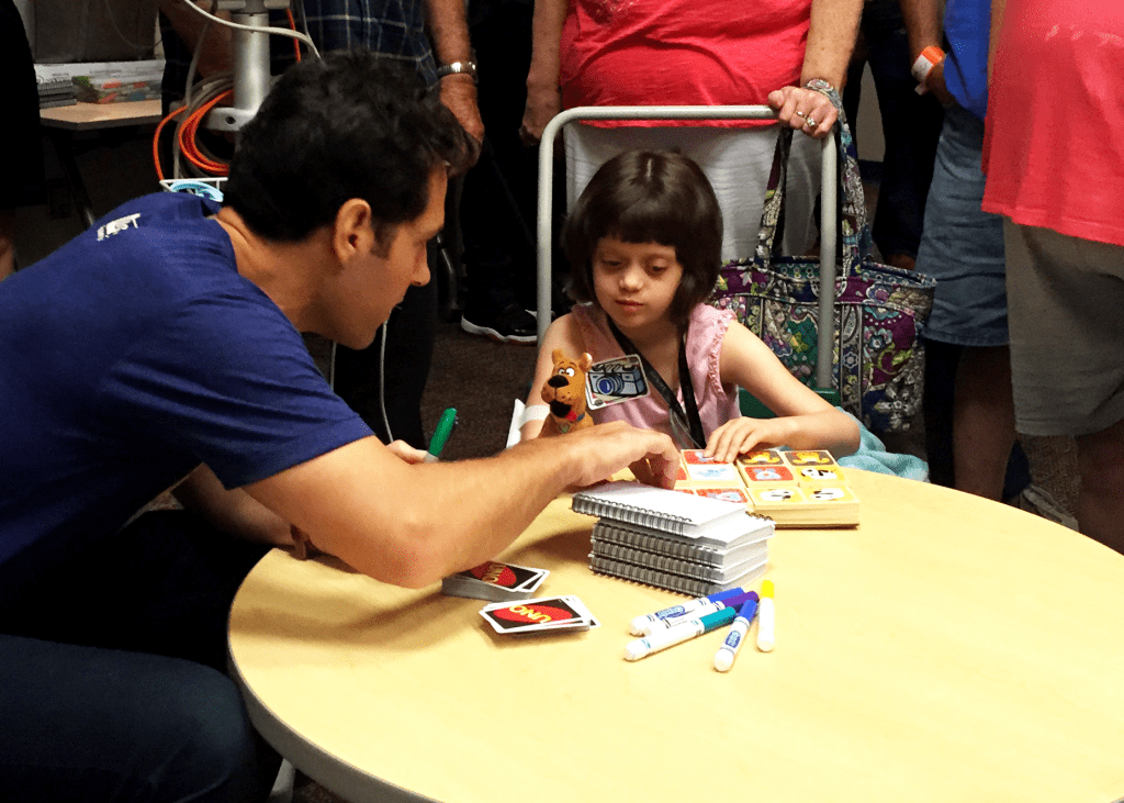 Paul Rudd being a REAL life Superhero by donating his time and playing with a girl named Abby Logan from Children's Mercy Hospital. This was during his Big Slick KC fundraiser.