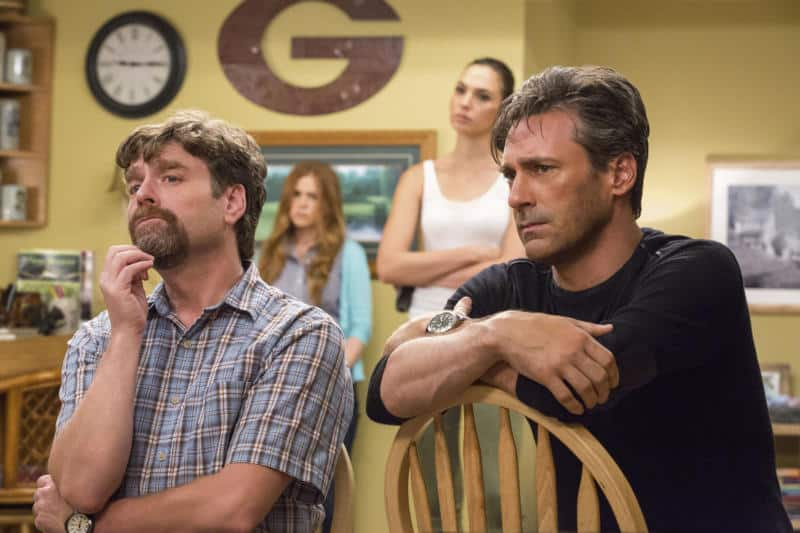 DF-13591_R2 - It's been a rough day for suburban couple Jeff and Karen Gaffney (Zach Galifianakis, Isla Fisher) and their neighbors, the covert spies Mr. and Mrs. Jones (Gal Gadot, Jon Hamm). Photo Credit: Bob Mahoney.